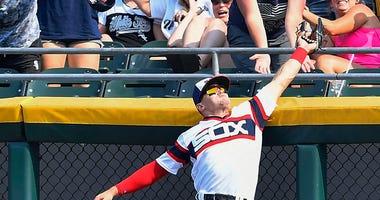 White Sox center fielder Adam Engel makes a catch at the wall.