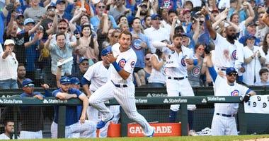 Cubs outfielder Albert Almora Jr. rounds third base as he scores a run.