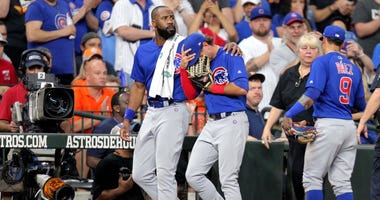 Cubs center fielder Albert Almora Jr. (5, center) is consoled by right fielder Jason Heyward (22, left) after a fan was hit by a foul ball off Almora's bat.