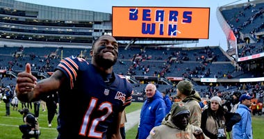 Bears receiver Allen Robinson (12) celebrates after his team's win against the Lions.