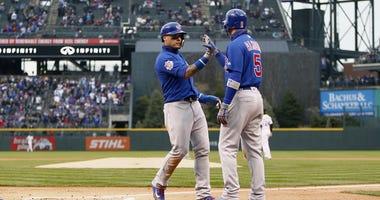 Javier Baez, left, is congratulated by Cubs teammate Albert Almora Jr.