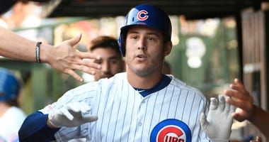 Cubs first baseman Anthony Rizzo (44) is greeted in the dugout after hitting home run against the Giants.