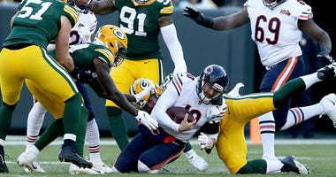 Bears quarterback Mitchell Trubisky (10) is tackled by Packers linebacker Blake Martinez (50).
