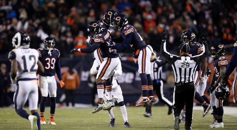 The Bears celebrate after cornerback Prince Amukamara (20) made an interception.