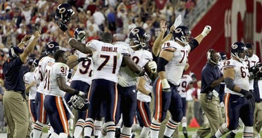 The Bears celebrate after a come-from-behind victory against the Cardinals on Oct. 16, 2006.