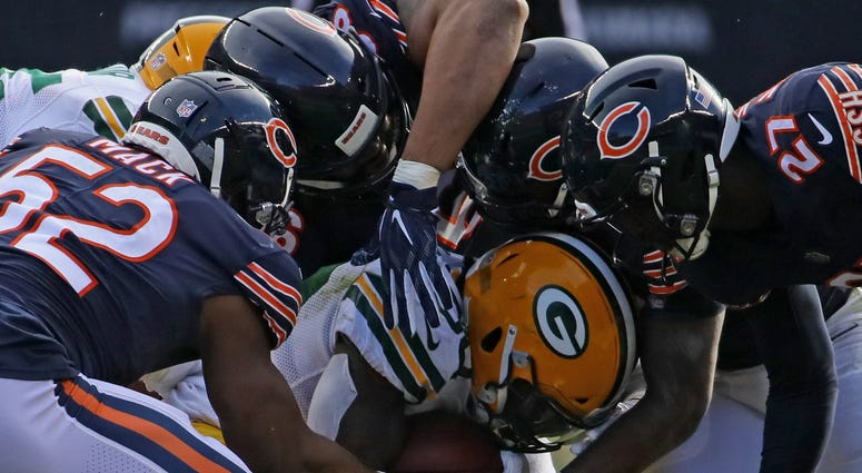 The Bears defense tackles Packers running back Jamaal Williams.