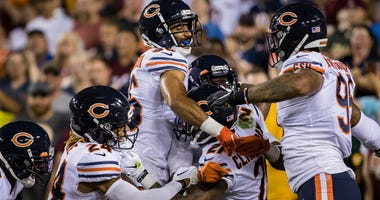 Members of the Bears defense celebrate after safety Ha Ha Clinton-Dix returned an interception for a touchdown against the Redskins.