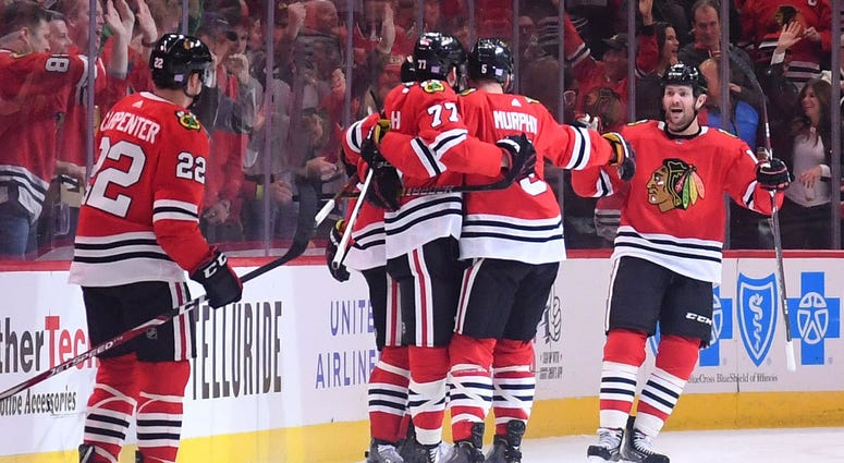 Blackhawks center Kirby Dach (77) reacts after scoring a goal against the Sabres.