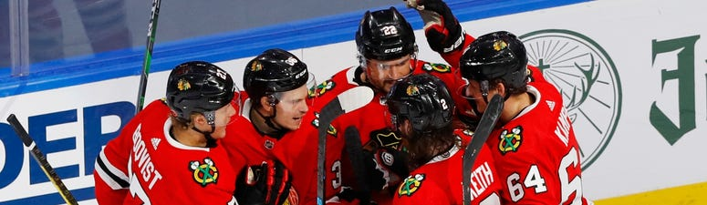 The Blackhawks celebrate a goal from forward Matt Highmore (36) in a win against the Oilers in Game 4 of their qualifying-round series.
