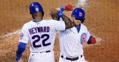 Cubs infielder David Bote, right, is congratulated by outfielder Jason Heyward after homering against the Cardinals.