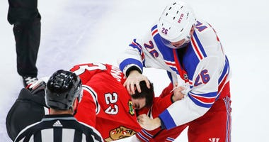 Rangers winger Jimmy Vesey (26) fights with Blackhawks defenseman Brandon Manning (23).