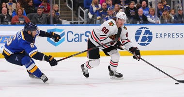 Blackhawks forward Brandon Saad (20) draws a penalty against the Blues.
