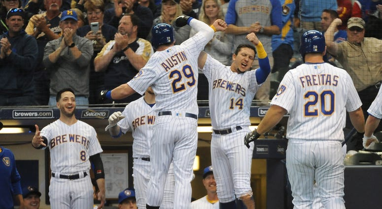 Brewers first baseman Tyler Austin (29) celebrates with third baseman Hernan Perez (14) after hitting a three-run homer against the Cubs.