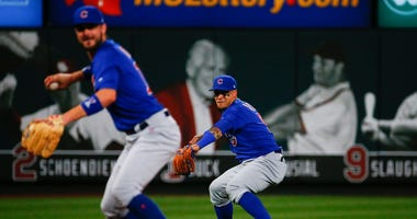 Cubs shortstop Javier Baez, right, mimics third baseman Kris Bryant's throw to first game in a game against the Cardinals in 2019.