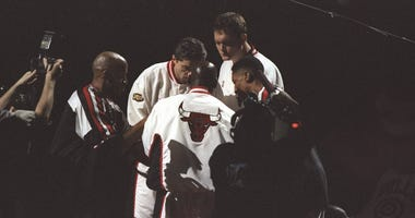 Bulls starters Ron Harper, Toni Kukoc, Luc Longley, Scottie Pippen, and Michael Jordan gather ahead of Game 4 of the NBA Finals in 1998.