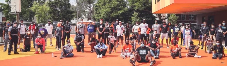 Eleven Chicago athletes meet with local groups and police officers.
