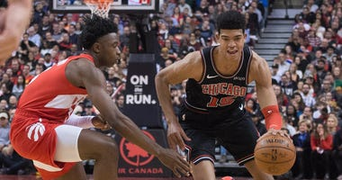 Bulls forward Chandler Hutchison (15) drives as Raptors forward OG Anunoby (3) defends.