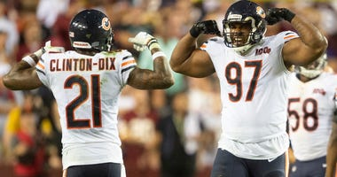 Bears safety Ha Ha Clinton-Dix (21) and defensive tackle Nick Williams (97) celebrate against the Redskins.