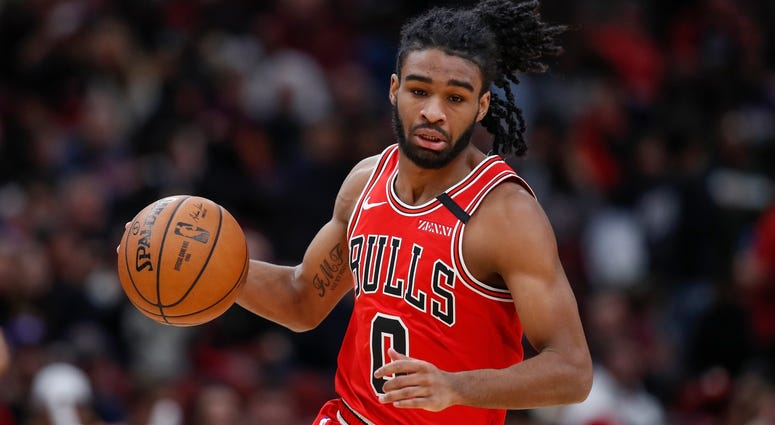Bulls guard Coby White (0) brings the ball up court against the Wizards.
