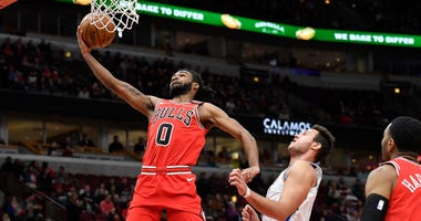 Bulls guard Coby White (0) scores against the Thunder.