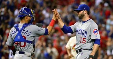 Cubs catcher Willson Contreras, left, and closer Brandon Morrow celebrate.