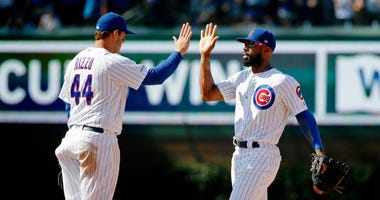 Cubs right fielder Jason Heyward (22) and first baseman Anthony Rizzo (44) celebrate a win against the Brewers.