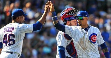 Cubs reliever Pedro Strop, left, and infielder Javier Baez celebrate a win.