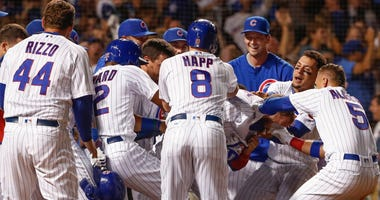 The Cubs celebrate David Bote's walk-off grand slam that gave them a win over the Nationals.