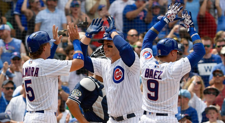 Cubs first baseman Anthony Rizzo (44) celebrates with center fielder Albert Almora Jr. (5) after hitting a grand slam.