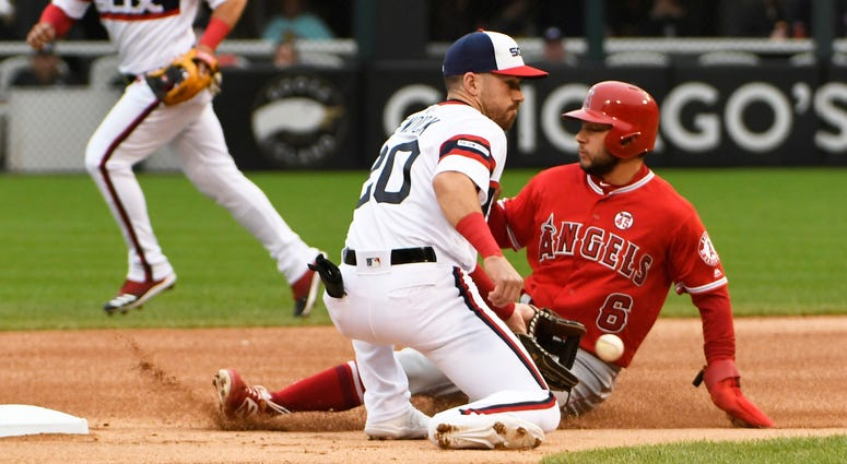 Angels shortstop David Fletcher (6) steals second base as White Sox shortstop Danny Mendick (20) makes a late tag.