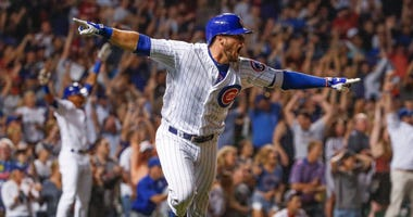 Cubs infielder David Bote celebrate his walk-off grand slam against the Nationals.