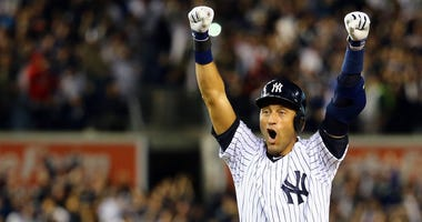 Derek Jeter reacts after hit a game-winning RBI single in his final MLB game.