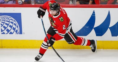 Blackhawks defenseman Duncan Keith (2) attempts a shot against the Canucks.