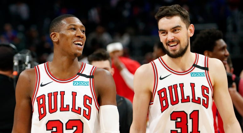 Bulls guard Kris Dunn (32) shares a laugh with guard Tomas Satoransky (31).after a win against the Pistons.