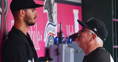 White Sox manager Rick Renteria (36) talks to right-hander Dylan Cease (84) after removing him against the Angels.