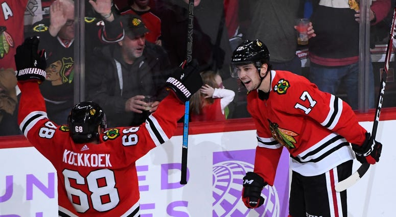 Blackhawks defenseman Slater Koekkoek (68) and center Dylan Strome (17) react after Strome scored a goal against the Kings.