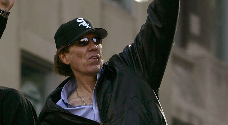 White Sox broadcaster Ed Farmer waves to fans during a parade to celebrate the team's World Series championship in 2005.