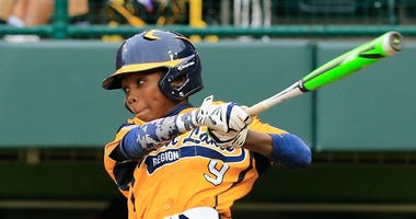 Ed Howard bats for Jackie Robinson West during the Little League World Series in 2014.