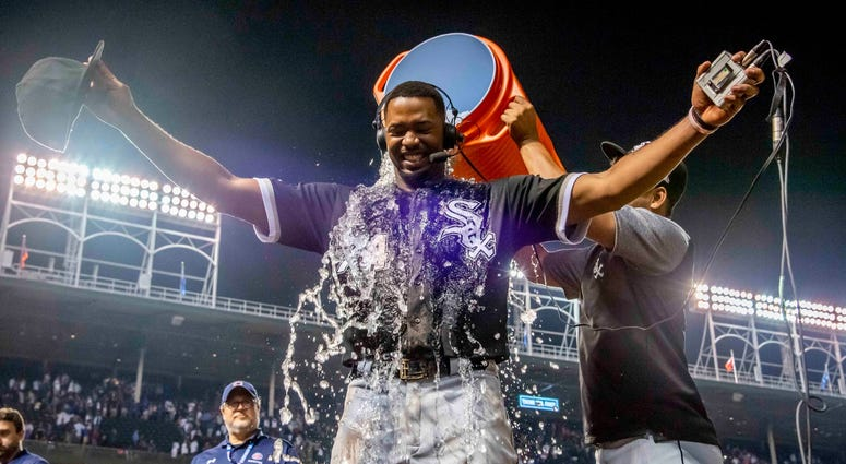 White Sox outfielder Eloy Jimenez (74) is doused after homering to lift his team to a win against the Cubs.