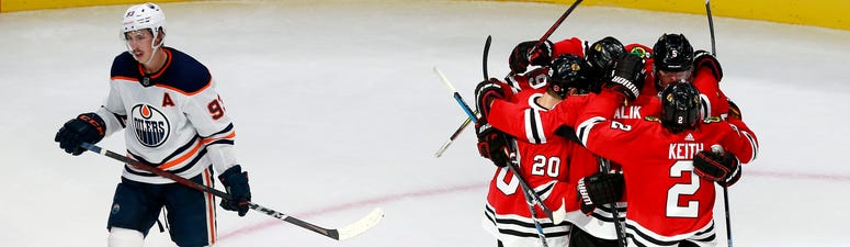 The Blackhawks celebrate Connor Murphy's game-winning goal against the Oilers.