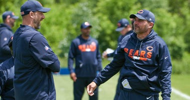 Bears coach Matt Nagy, left, and offensive coordinator Mark Helfrich