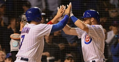 Ian Happ, right, is congratulated by Cubs teammate Victor Caratini after homering.