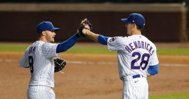 Cubs right-hander Kyle Hendricks (28) celebrates with outfielder Ian Happ (8).