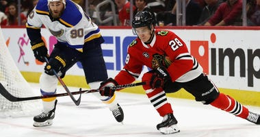 Blackhawks defenseman Henri Jokiharju (28)