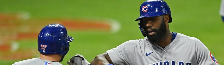Cubs outfielder Jason Heyward (22) celebrates with second baseman Jason Kipnis after homering against the Indians.