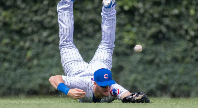 Cubs outfielder Ian Happ can't corral an eventual double by the Dodgers.
