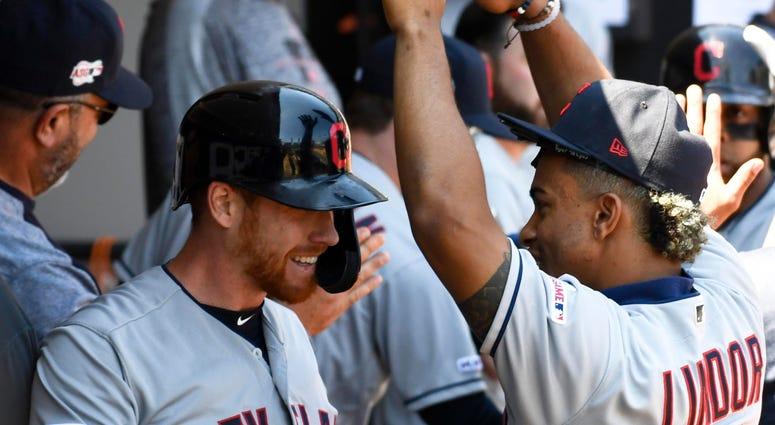 Indians right fielder Jordan Luplow, left, and shortstop Francisco Lindor celebrate after Luplow homered.
