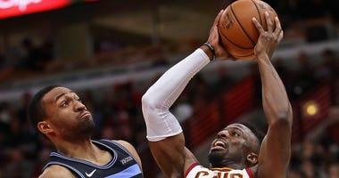 Bulls forward Jabari Parker, left, defends Cavaliers wing David Nwaba.