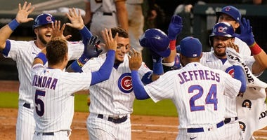 Javier Baez, center, is greeted by Cubs teammates in celebration after his walk-off single lifted Chicago to a win against Pittsburgh.