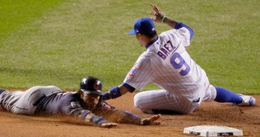 Cubs infielder Javier Baez tags out Indians shortstop Francisco Lindor in Game 5 of the 2016 World Series.